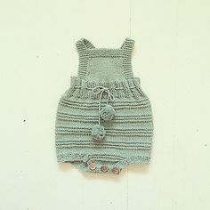 Romper Suit with ribbon and pom poms