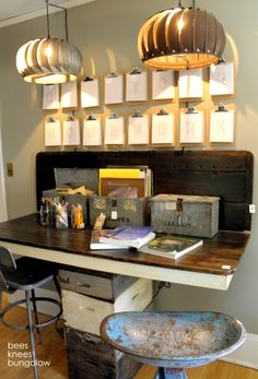 Old vents as light fixtures - fabulous.  Crates as the center table 'leg'.  Clipboards as wall art - fabulous.
