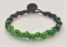 Wicked by MariaOfAllTrades on Etsy (beaded kumihimo inspired by Once Upon A Time's Wicked Witch of the West, Zelena)