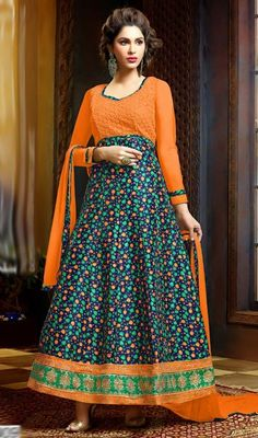 Bring an alluring glow to your face with this Anarkali suit in orange and blue color chiffon. This pretty attire is showing some wonderful embroidery done with lace and resham work.  #chiffonanarkali #floralprintanarkalidress #longanarkalisuits