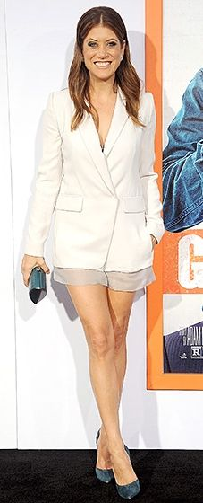 Bad Judge's leading lady flaunted her fierce gams in a white tuxedo-style dress by Kaufmanfranco, accessorized with a Rodo bag, Kwiat jewels, and teal shoes.