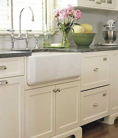 Kitchen Sink with Old-fashioned Elegance        It's the best of both worlds. This old-fashioned apron-front sink is adorned with vintage-looking (but modern) bridge-style faucets.