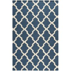 This patterned blue wool rug combines bright, modern colors with a traditional Moroccan pattern. The simple pattern is eye-catching, but not overpowering, and the quality wool fibers provide enduring strength that will hold up over the years.