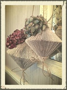 Book art mobiles, with hydrangea blossoms