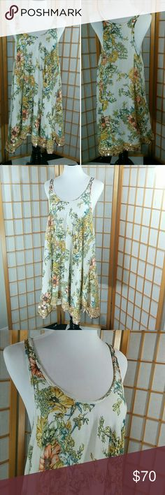 """Free People swing dress sequined hem Free People flowered, flowy swing dress, with wide arm holes, and embroidered and sequined hem. Gorgeous. 18' from armpit to armpit and 30"""" long, size small. Very good condition. Free People Dresses"""