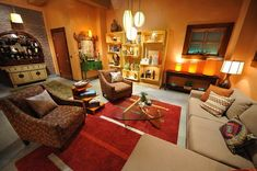 Brennan's Loft from 'Bones'. Living room.  Love the warm rich colors, especially on the walls.