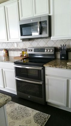 GE Slate appliances with antique white cabinets