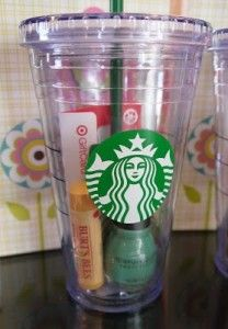 Gift idea-eos chapstick, gold sparkle nail polish, target gift card, candy cane, all in Starbucks tumbler