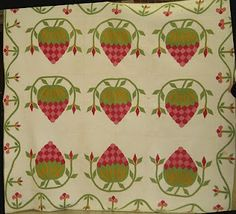 Strawberry Quilt circa 1850.  I have this pattern and the template.  Going to make it one day....