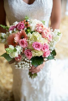Beautiful & Dreamy Wedding Bouquet Featuring: White Hydrangea, White Gypsophila, White Snapdragons, White Roses, Pink Spray Roses, Peach Gerbera Daisies, Coral Hypericum Berries, Green Hypericum Berries, Green Foliage