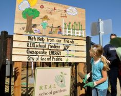 A picture of the garden entry sign at Sallye Moore Elementary School