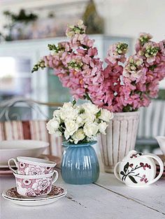 Mix and Match vintage pottery and china for fresh flower arrangements this summer