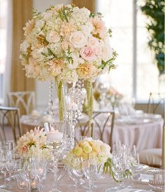 This link has several Fabulous, Floral Wedding Centerpieces for inspiration.  we love this first centerpiece with hanging amaranthus and crystals!
