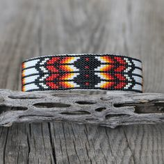 """Fabulous colors and patterns. Navajo artist, Joyce Devore hand beaded this exquisite bracelet. The bracelet is backed with a soft leather. The entire inner circumference is about 7"""", including 1"""" opening. 7/8"""" wide When trade..."""