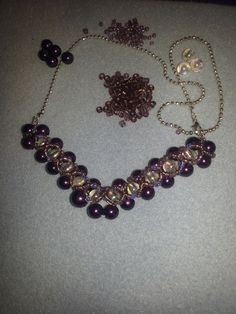 v shaped necklace with crystal overlay on the beads