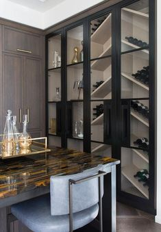 Floor to ceiling glass front display cabinets are fixed beside floor to ceiling glass front wine cabinets fitted with angled wine shelves. Wine Glass Shelf, Glass Shelves In Bathroom, Wine Shelves, Wine Wall, Bathroom Niche, Shower Niche, Wine Storage, Floating Shelves, Kitchen Display Cabinet