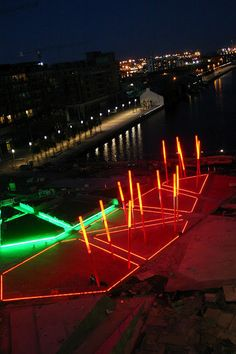 #Lighting design: Red carpet, made of bright red resin-glass paving, Grand Canal Square Dublin