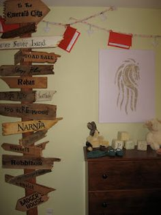 Eowyn's Nursery: Book garland, Rohan horse crest, and Fairytale signposts.