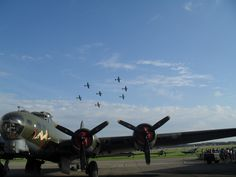 B-17 'Sally-B' at the IWM Duxford airshow in September 2011, with seven Spitfires flying above her.