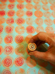 Julie B Booth: printing in layers, milk bottle top in orange on bottom, battery in red on top. Printing on fabric