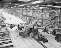 """This is an interesting photo - captioned """"Assembly line production of B-24 Liberators"""" but where are the rest?  Is this perhaps the last in this line?  Clearly heavily autographed."""