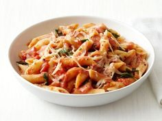 Toss penne noodles with a dressed-up tomato sauce featuring a dash of red pepper flakes and splashes of vodka and cream.