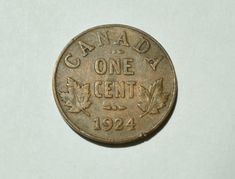"Top 10 Rare Canadian Pennies include the 1936 dot penny, the 1955 ""No Shoulder Fold"" (NSF) and 1954 NSF. These are very valuable pennies indeed. Valuable Pennies, Rare Pennies, Valuable Coins, Canadian Penny, Canadian Coins, Thousand Dollar Bill, Old Coins Worth Money, Penny Values, Coin Auctions"