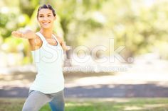 Smiling Woman Practicing Yoga In Warrior 2 Pose royalty-free stock photo