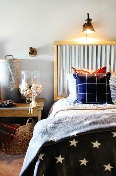 Navy bedroom with corrugated metal headboard.