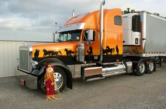 Custom orange and black truck next to it's matching scarecrow. #trucks  #GATS  #trucking  #trucktires  #continental  #continentaltire  #tires
