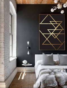 Black accent wall with graphic gold detail modern living room