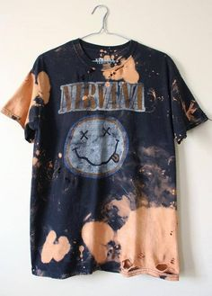 Each bleached shirt is one of a kind and cant be duplicated. This one is a Nirvana smiley tee, all cotton. It has distressing strategically placed all over the shirt including the collar, sleeves, front, back and the bottom hem. Heres your info on it - - Size Medium, check measurements please - Across chest flat, pit to pit - 20 (40 around) - Shoulder seam down - 28 If you need more info or have any questions, just yell, were around to help you out. If youre ordering from a location n...