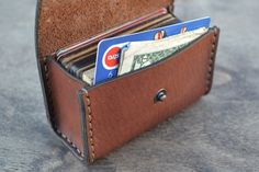 Cardholders made of genuine leather harness saddle. Closes the button. Impregnated natural castor and linseed oil. The edges are treated with natural beeswax. Manual two needle stitch. Holds approximately 50 standard cards. It is possible to use a small amount of paper of stacked paper money. Can also be used for business cards. Available colors dark brown (dark chocolate), cognac, brown.  Other cardholders can be seen here: https://www.etsy.com/shop/sergklim?section_id&...