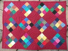 Idea for Amish quilt. 9 square patches from solid color strips and a black background.