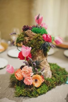 adorable centerpiece with moss, flowers and driftwood