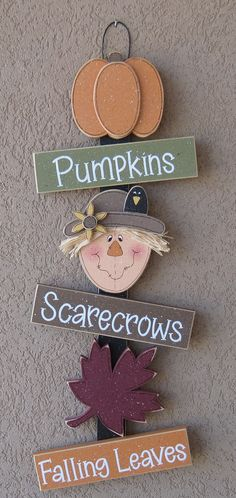 * Vertical hanging Fall décor sign.  * Adorned with an Pumpkin, Scarecrow, and Leaf.  * The perfect addition to your Fall décor.  * Great for gifts for teachers.  * Sign measures approximately 8 wide by 22 tall by 1 thick(all pieces are 1/2 thick). * 100% hand crafted in the USA.  * Original copyrighted designs by Lisa Bees Craft and Design