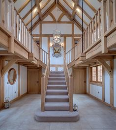 A welsh Oak Frame house with a light and airy oak hallway with beautiful oak staircase and high ceilings. House Staircase, Staircase Design, Barn Conversion Interiors, Oak Framed Buildings, Oak Frame House, Self Build Houses, Log Cabin Furniture, Barn House Plans, Pole Barn Homes