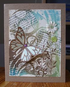 3D butterfly on collage-y background,swirls and HA Friends word stamp