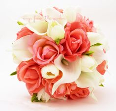 Coral Real Touch roses with Real Touch white calla lilies and Real Touch white mini tulips create a lovely flower bridal bouquet that can be
