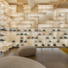 Japanese architect Kengo Kuma has covered the interior of Camper's Milan store in a grid of pale ply that stretches from floor to ceiling.