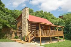 This Away cabin rental near Pigeon Forge, TN. This Away is a wonderful two-bedroom cabin that is great for two couples or one small family. This cozy cabin features a fishing pond right next it and is pet friendly! Relax in the quiet mountain setting in the spacious hot tub or take advantage of the Jacuzzi tub in the bathroom. At the end of an adventurous day gather around the fireplace and watch a movie or relax on the covered deck under the stars.