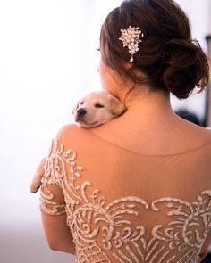 Puppy from Causes for Animals fast asleep on bride's shoulder with gorgeous pearl hair accessory // Together with a real bride, groom and their bridal party of 13, TWS had the pleasure to hold our very first socially-conscious styled shoot with rescued puppies and dogs from two animal welfare charities Causes for Animals - Singapore and Exclusively Mongrels Limited! It was a Sunday well spent {Facebook and Instagram: The Wedding Scoop}