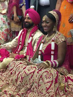 Sikh wedding in Gurdwara. Sikh punjabi groom, black Jamaican bride.
