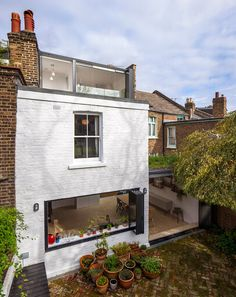 Studio 30 has transformed a terraced house in west London with a new loft bedroom and an enlarged family kitchen, both featuring walls that fold open to offer better views of a garden and nearby park House Extension Design, Extension Designs, Roof Extension, House Design, Loft Design, Design Design, Victorian Terrace, Victorian Homes, Victorian Kitchen