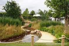 Zoflora: Outstanding Natural Beauty was designed by Helen Elks-Smith, and built by Wycliffe Landscapes Ltd. This Show Garden was sponsored by Zoflora. The RHS judges awarded the garden a Gold Medal and the prestigious title of Best Construction Award, at the RHS Hampton Court Palace Flower Show 2016. The design for this Show Garden was inspired by the patterns and materials found in Yorkshire. The drystone walls define the garden with their curving shape which echoes the curves and stone in…
