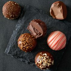 A perfect gift for entertaining or for the end of a dinner party, these rich truffles come in a range of enticing flavors, from classics like rocky road, crème brulée, and pecan pie to playful favorites such as strawberry, coffee mousse, and chocolate ganache. #chocolate #truffles