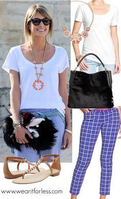 Helena Bordon at Paris Fashion Week street style in a white tee and blue striped pants with a Fendi fur handbag