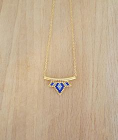 Small blue lotus woven tube necklace Woven beads, gold, dark blue, clear, size 2, 2 x 1, 7 cm Weaving mounted on a tube and gold fine 16 k size of all 3 x 1, 7cm Chain gilded in gold fine 16 k 2 x 1, 5mm (length 36cm) Gold filled clasp closure Small 4cm extension chain to better adjust size Total length with approximately 40cm extension chain. Very good stability over time For more information dont hesitate to contact me! :) Facebook page: Noo - Sha (Reproduction) (Care instructions: for ...