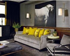 Bright yellow pillows are the perfect pop of brilliant color for this neutral room.