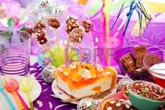 colorful decoration of birthday party table with cake and sweets for child photo